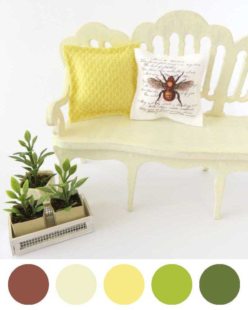 Piante finte e cuscini a tema ape ambientati in miniatura