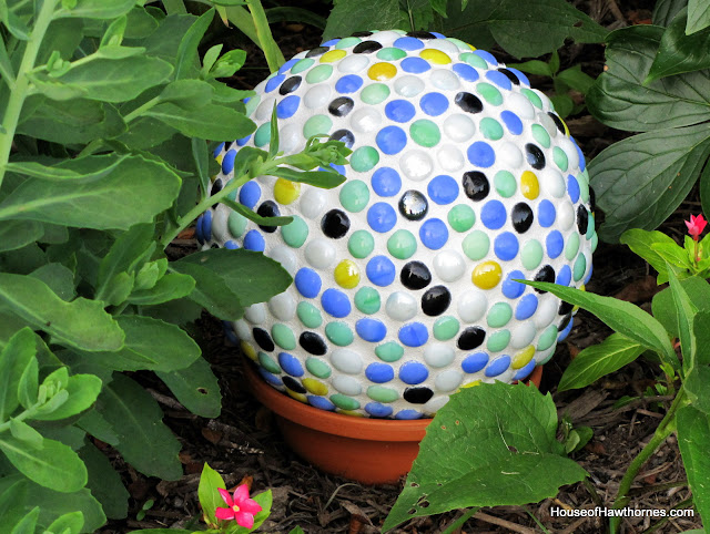 DIY fun yard art for your garden made from a bowling ball from houseofhawthornes.com