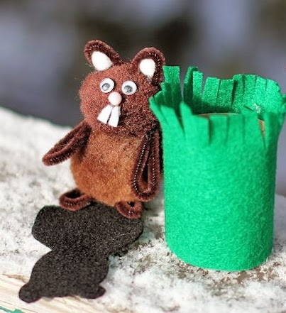 http://aboutfamilycrafts.com/how-to-make-a-groundhog-play-set/