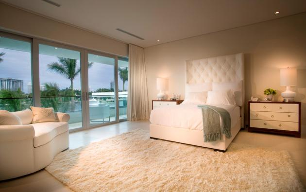 Large modern bedroom in the Modern Villa by Touzet Studio