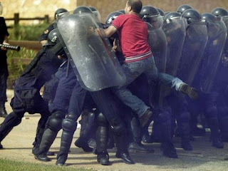 Funniest pictures of police: demonstrator jumps on mobile unit