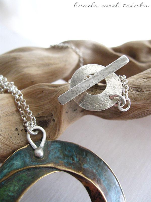 Chiusura e agganci del pendente in argento fatti a mano