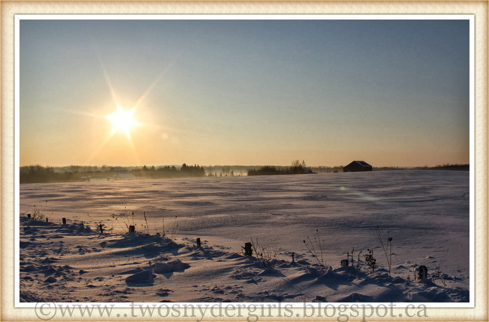 Sunrise over a winter field