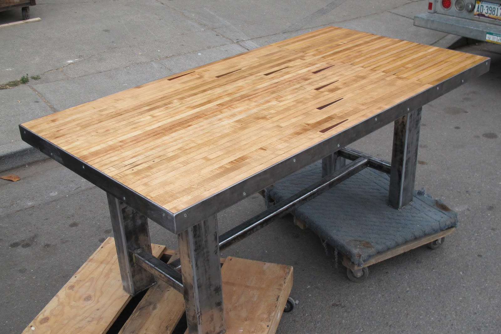 Industrial Steel Base Dining Table From Maple Bowling Alley Slab.