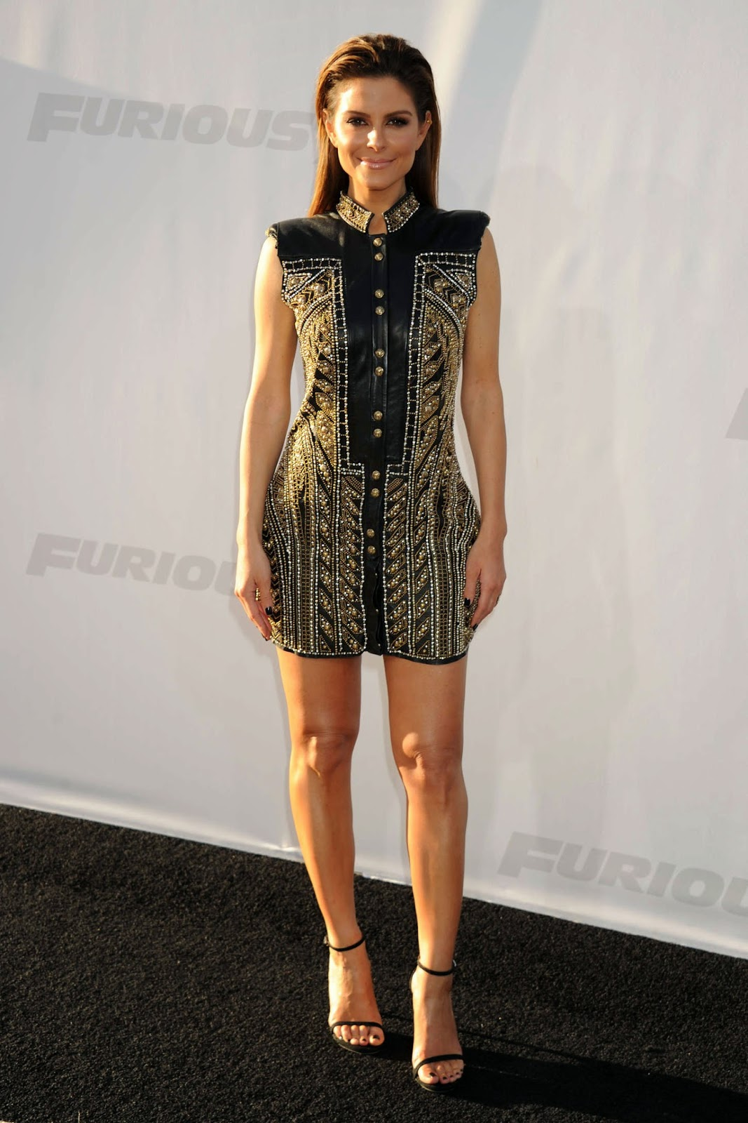 Maria Menounos in an embellished mini dress at the 'Furious 7' premiere in LA