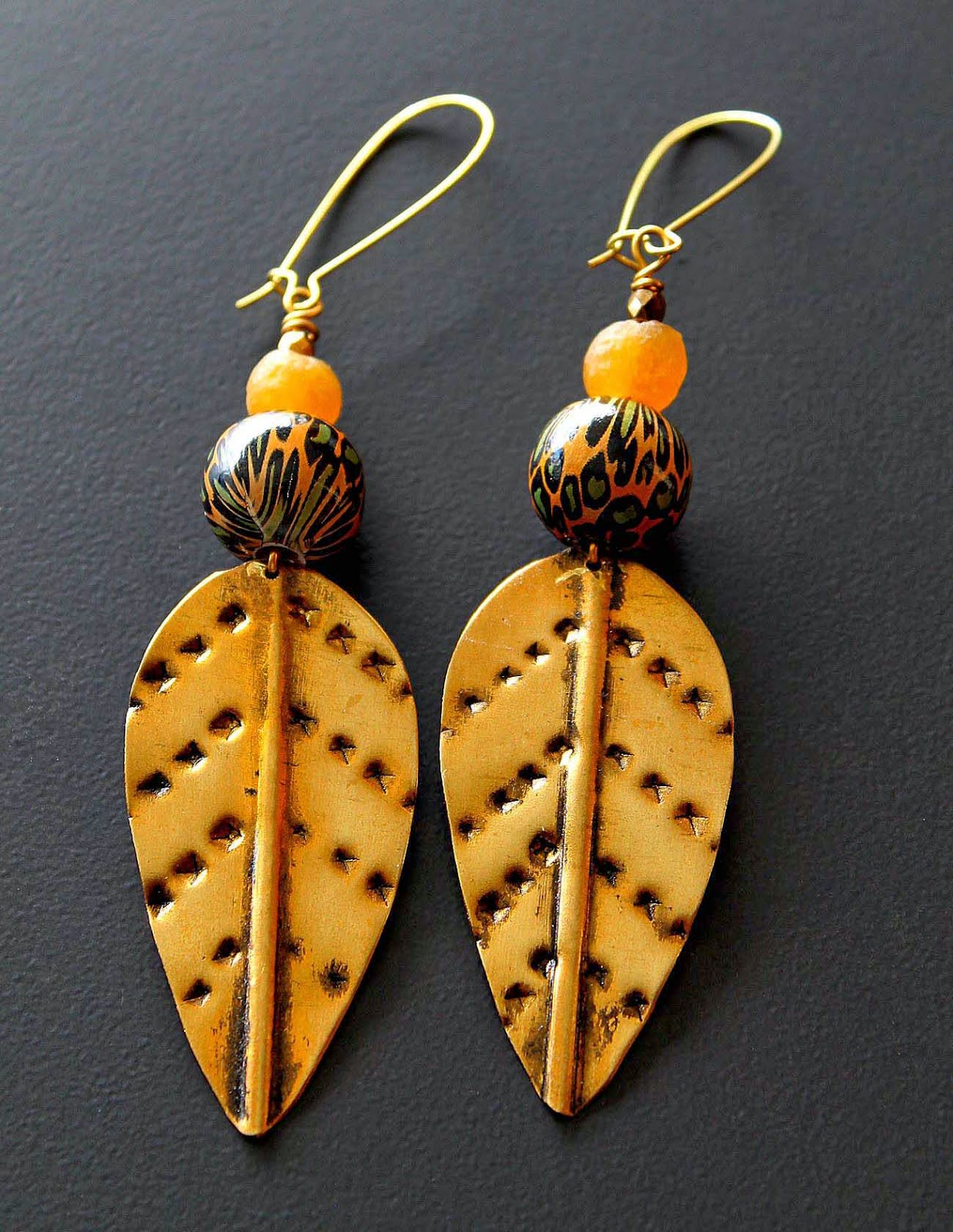 african brass spear head earrings