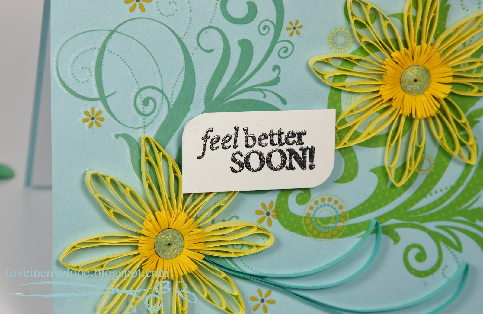 This card features 2 yellow quilled flowers. The centers were made
