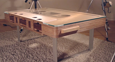wooden table which looks like a cassette tape. Image taken from right corner just above table level