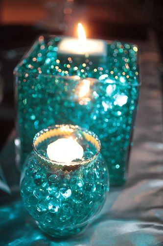teal glass centerpieces