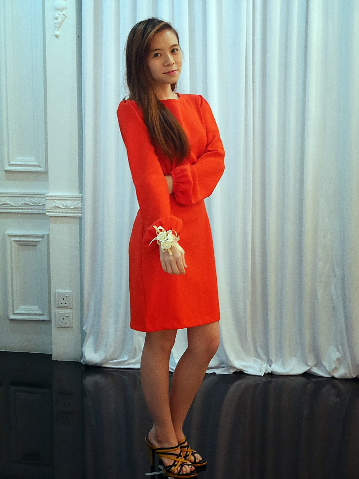 Girl in bright orange dress
