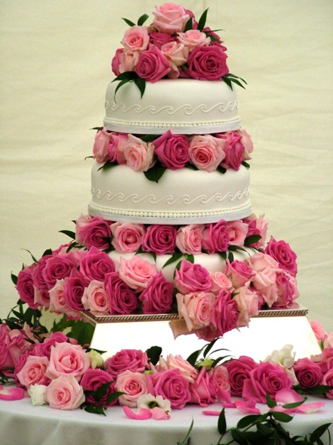 white wedding cakes with red roses. Fully roses wedding
