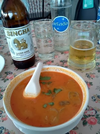 Tom Yum Kung soup and Singha beer.