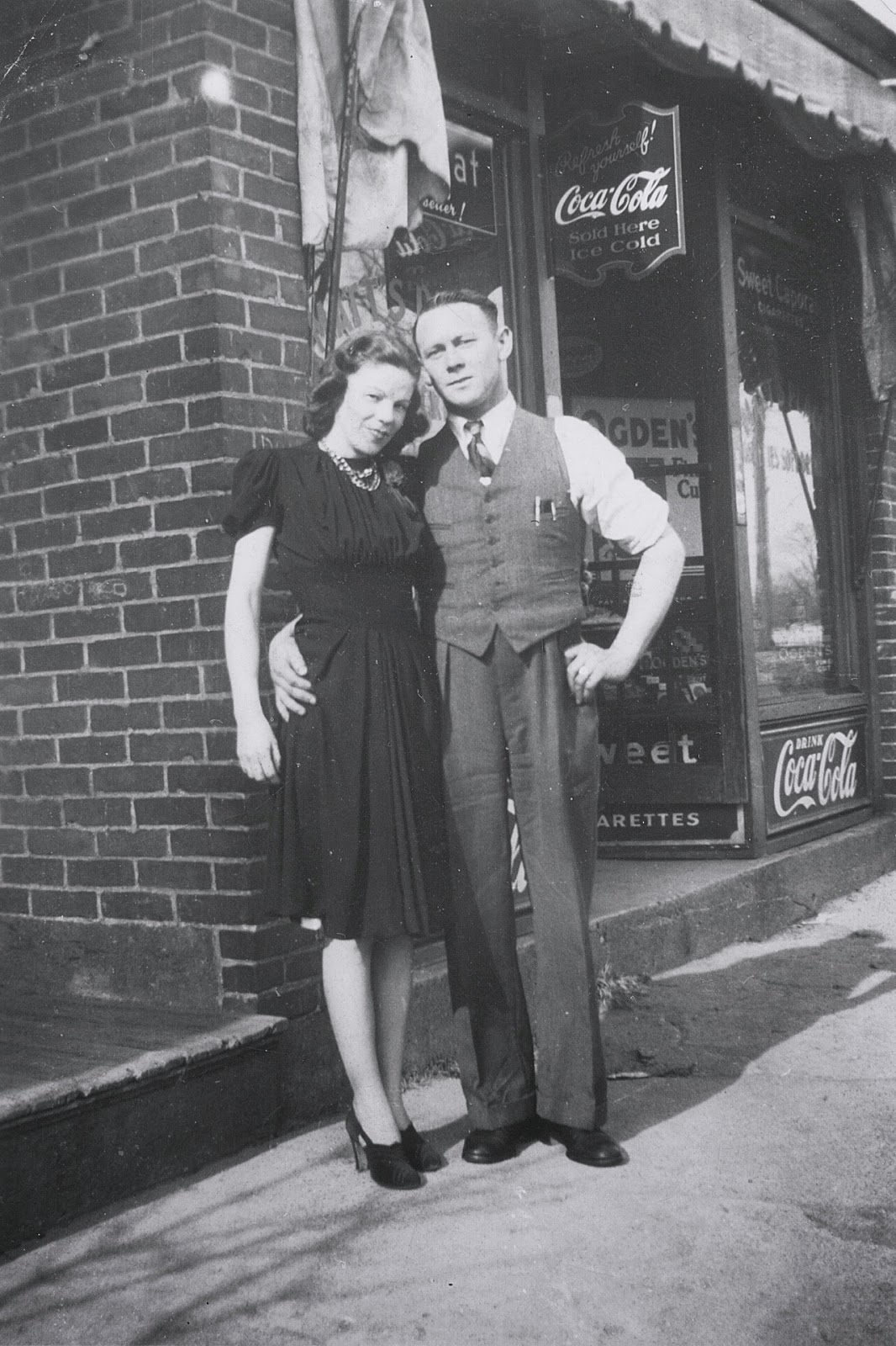 Daniel and Fleur-Ange Larkin in front of the store, circa late-1930s. This photo gives the best view of the full front window of the store.