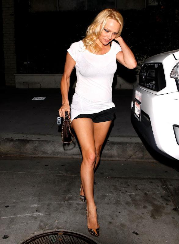 Pamela Anderson earing a tiny black shorts