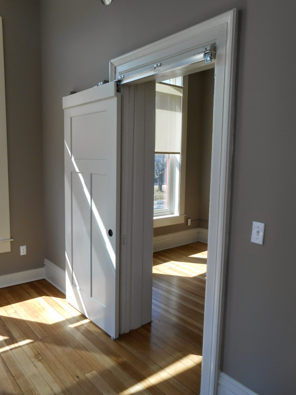 Swinging kitchen doors residential - Since Space Has Been Borrowed From This Room For A Commodious Closet And One Of The Closets That Opens From The Kitchen Dining Room It S A Small Space