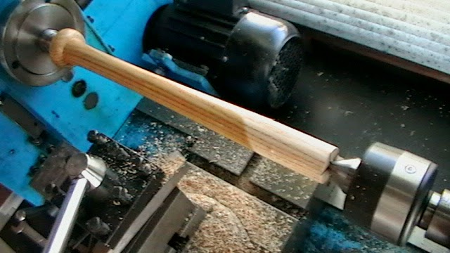 Turning the baseball bat handle.
