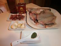 Dorada con aceite de ajo y jamón iberico