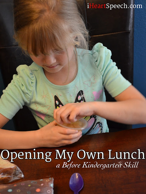a kindergarten child opening her lunch items