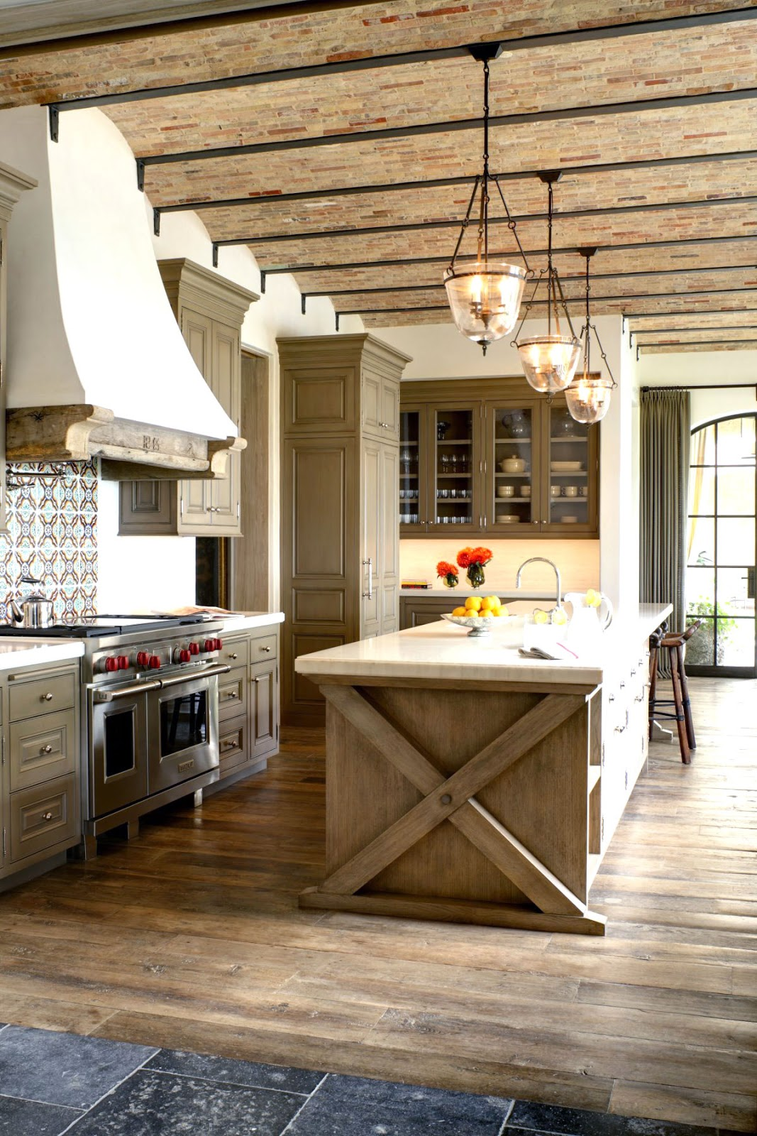 Kitchen with brick ceiling and rustic wood floor