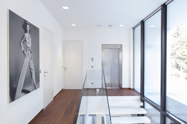 Upper floor hallway with glass railing