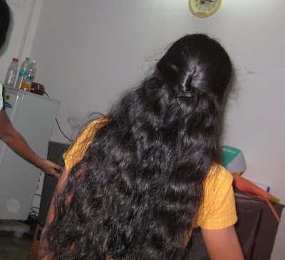 Homely kerala long hair girl busy at work
