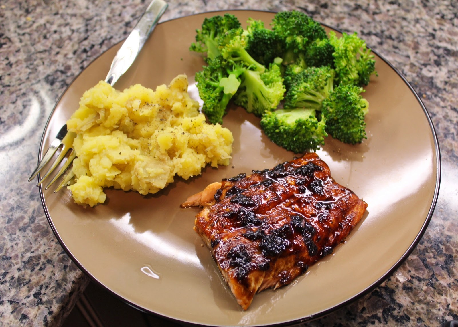 Salmon, mashed potatoes, and broccoli