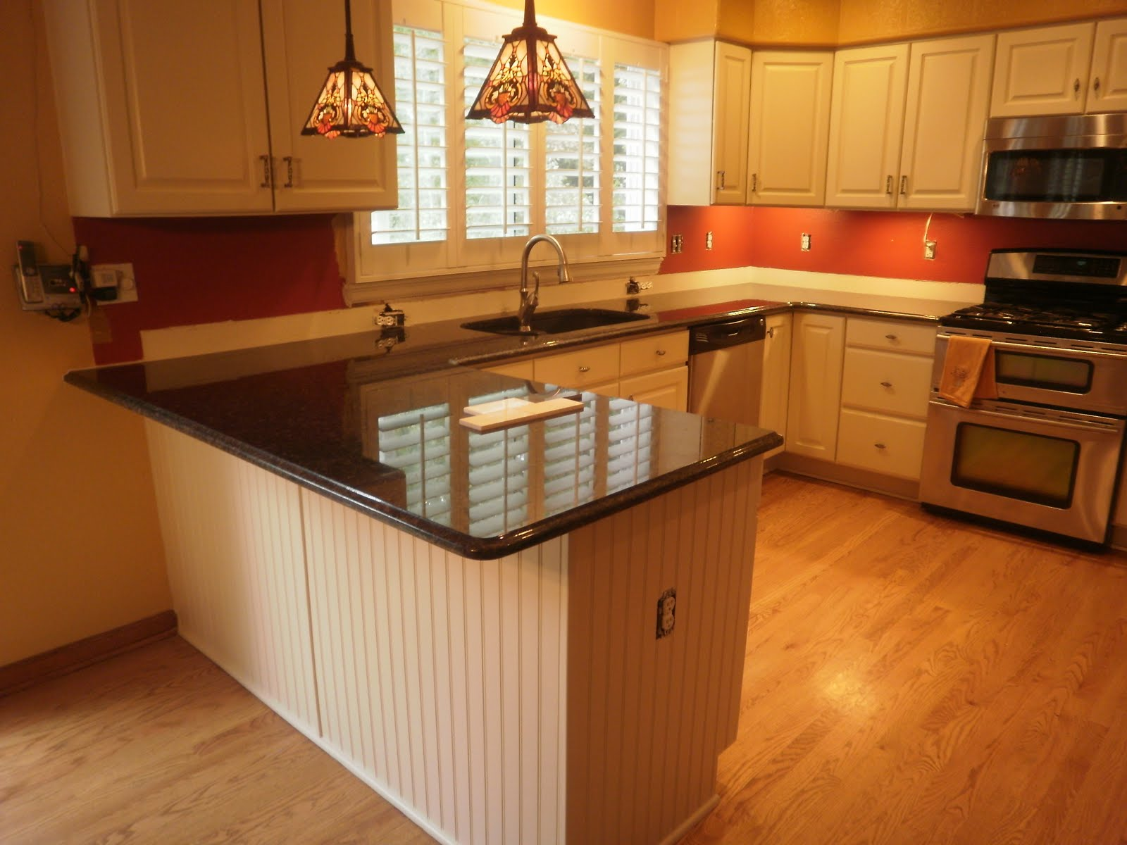 Granite Countertops And White Cabinets By Colorado Cabinet Coatings