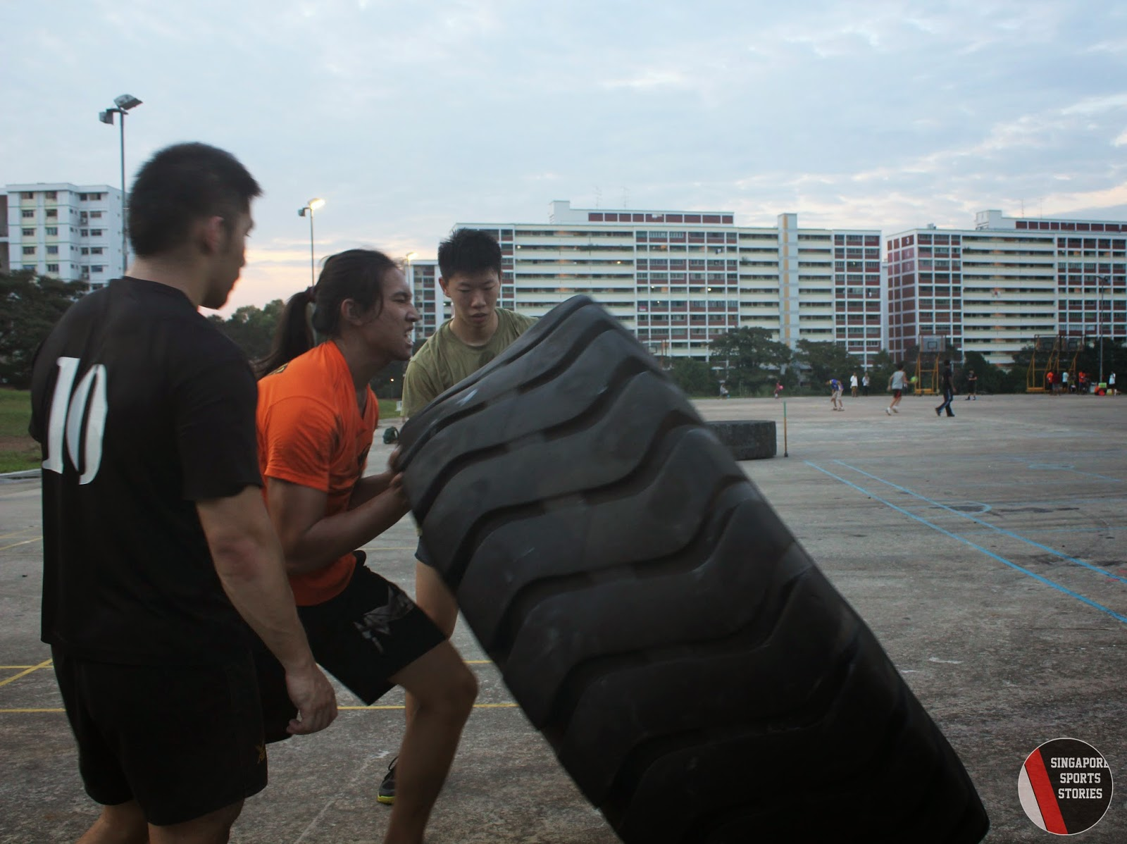 Members of Singapore Strongman group, SG Titans, performing the tyre flip