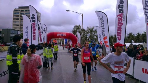 Runners catching their breathe at the finish line
