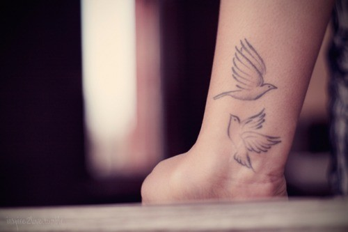 Cute two soaring birds tattoo on wrist