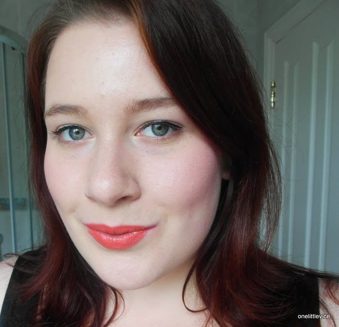 bright orange lipstick swatch