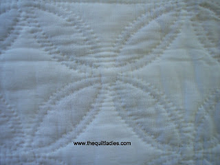 stitch back of white quilt