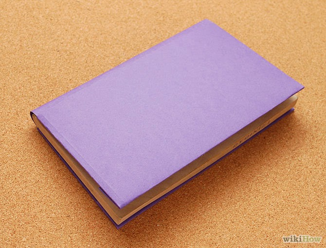 How to Cover a Book With a Paper Folder