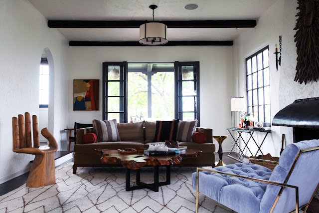 eclectic living room decor decorating exposed beams french doors hand chair leather sofa moroccan rug