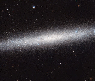 ON EDGE SPIRAL GALAXY NGC 5023