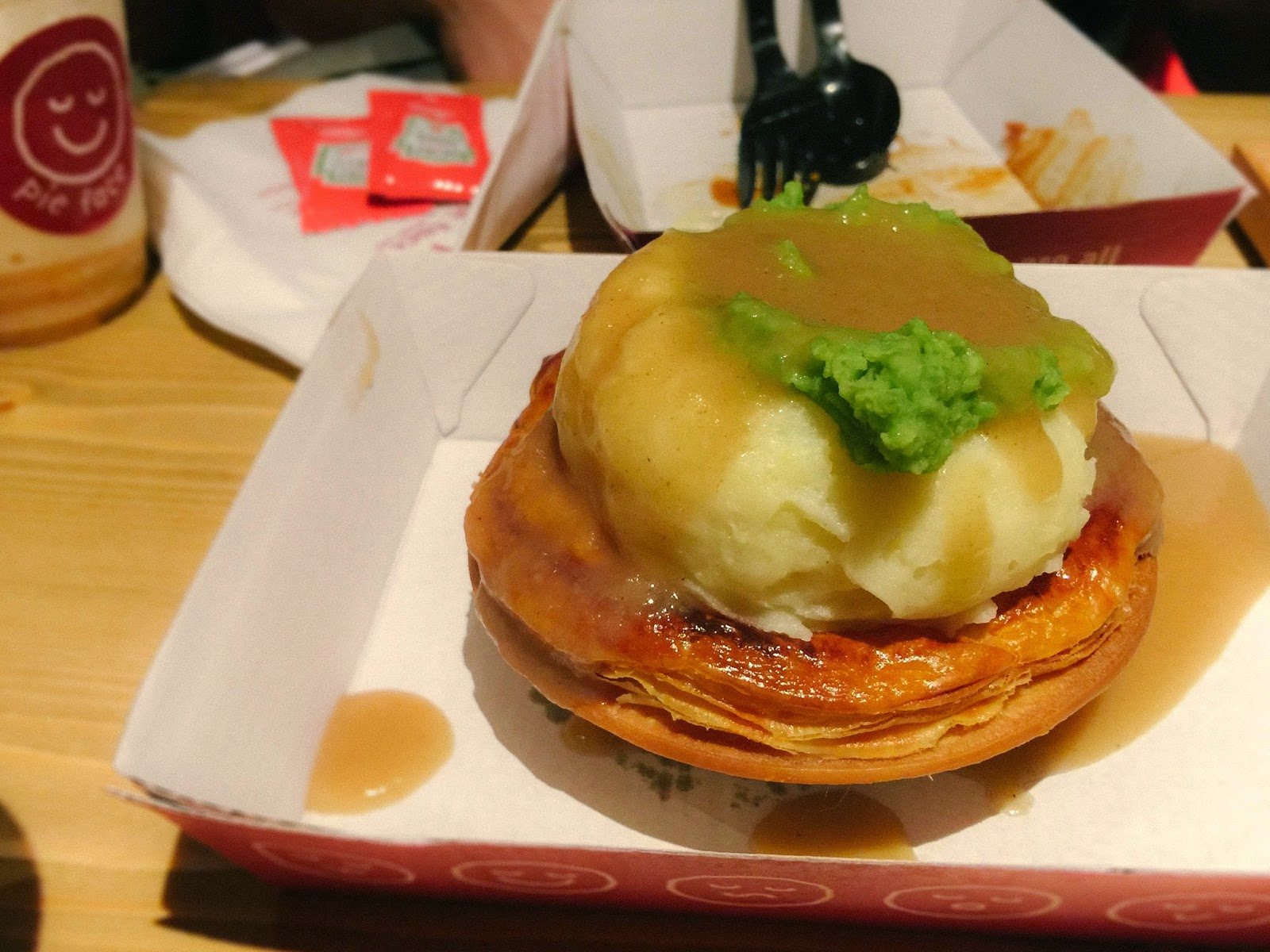 mash, gravy, mushy peas in pie face