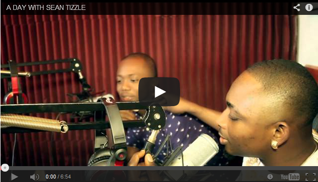 http://music-omoooduarere.blogspot.com/2014/01/video-day-with-sean-tizzle_10.html