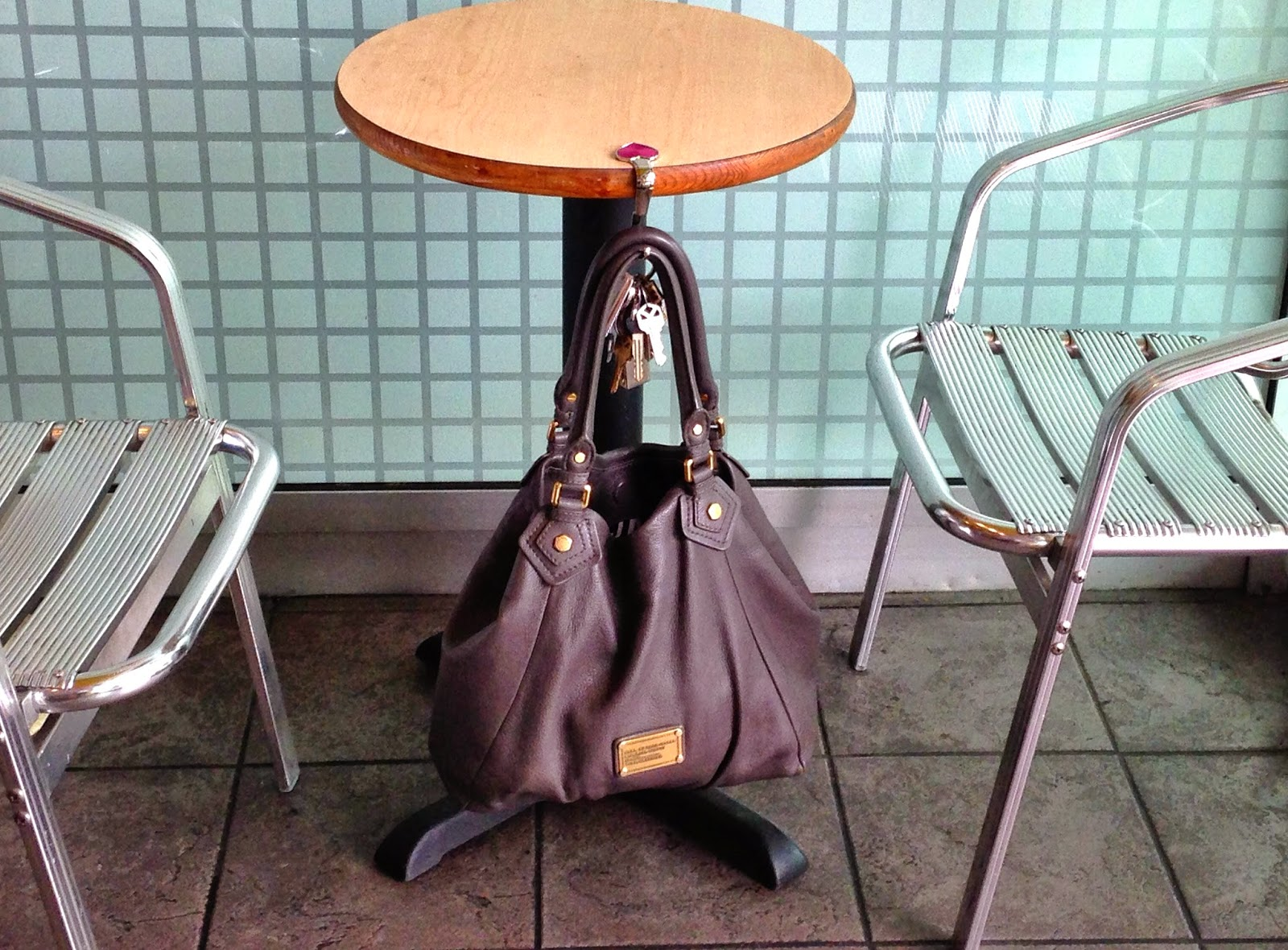 My Bag Pal hanging from a table - Hello Handbag