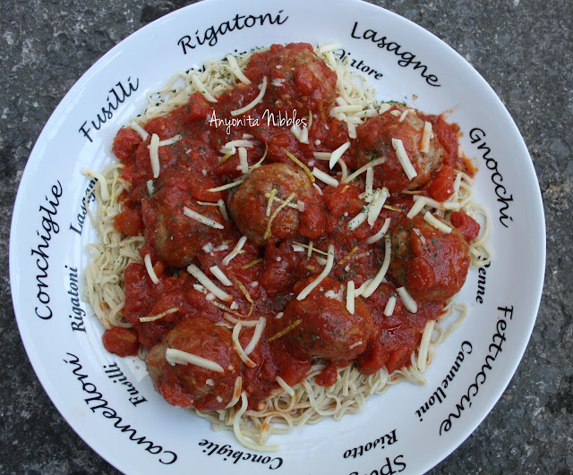 A serving dish of DIY spaghetti, turkey meatballs and tomato sauce from www.anyonita-nibbles.com