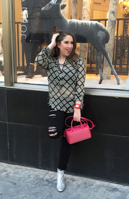 The High Heeled Brunette, Marisa Stewart shows how to get a pop of color by wearing a pink studded Saint Laurent bag and a red La Mer Collections watch