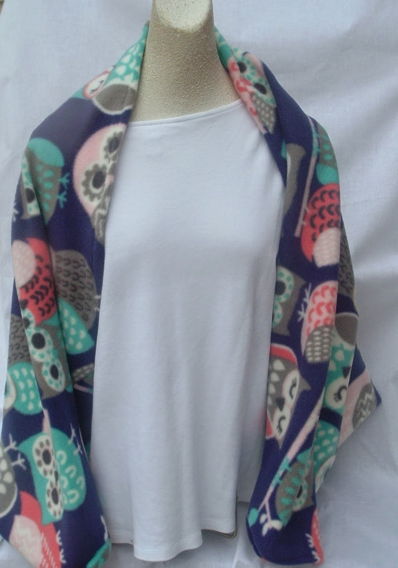 http://www.storenvy.com/products/6135520-owl-fleece-shrug