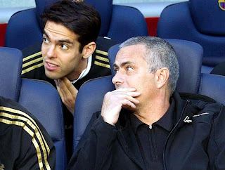 Mourinho with Kaka talking on the bench