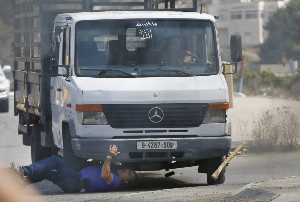 70 Of The Most Touching Photos Taken In 2015 - A Palestinian vehicle strikes an Israeli motorist, who died later, in the West Bank city of Hebron.
