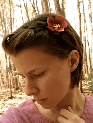 pink and purple hair accessory clip in french braided short hair style