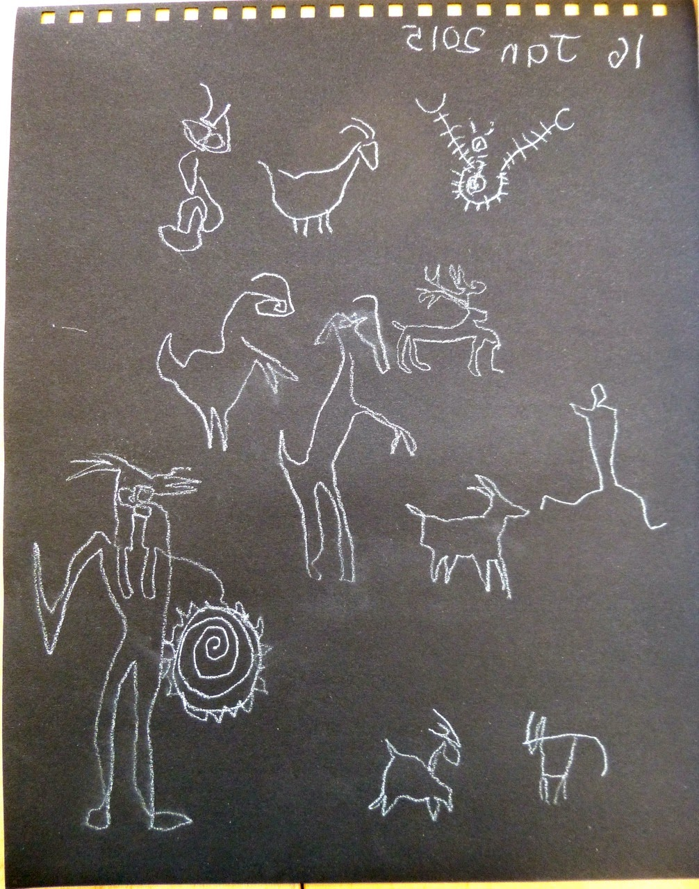 Rock art white on black drawn with left hand whilst drawing...