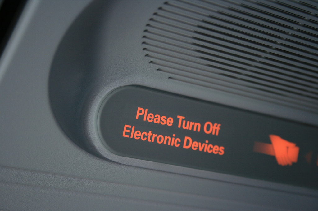 Turn off electronics sign