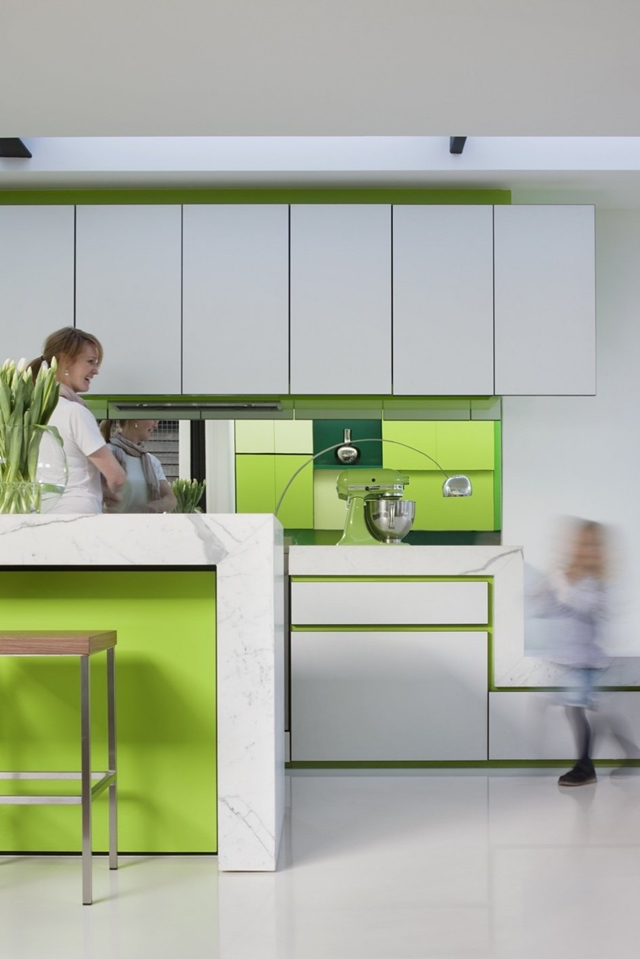 White minimal kitchen with green panels