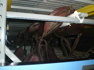 Museum storage of historic leather saddle artifacts, antiques, Military, art conservation