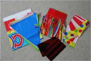 birthday express carnival kit and red curtain backdrop