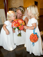 The flowergirls and Jillian checking out her bouquet.  Cute!